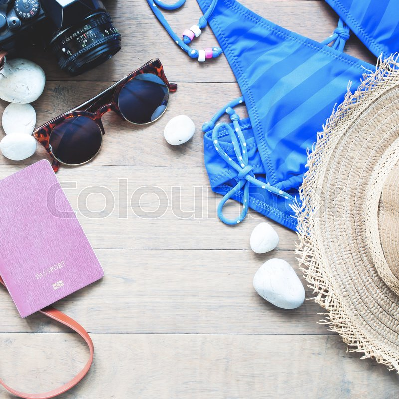 Stock image of 'Summer items for women, beach summer collection on wood background'