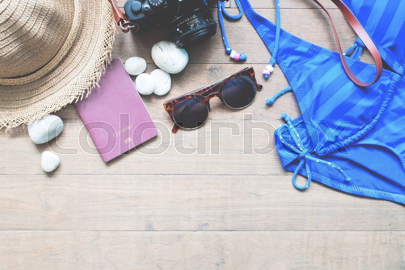 Stock image of 'Summer travel concept with passport and camera, Top view of summer collection on wood background with copy space'