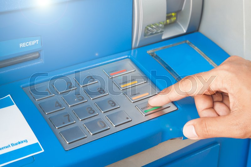 Stock image of 'Hand of a man push enter button on atm machine'