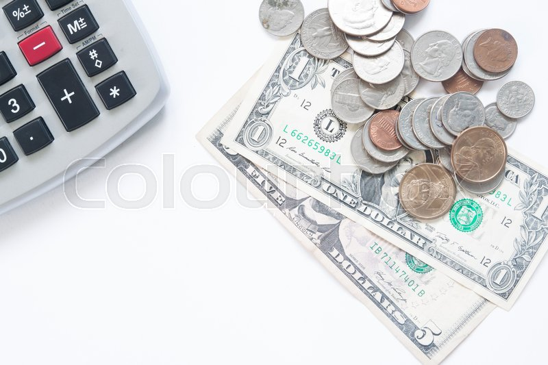 Stock image of 'American money dollar with calculator on white background with copy space'