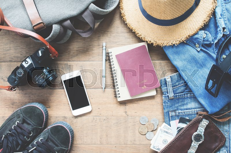 Stock image of 'Overhead view of man's accessories, Traveler items on wooden background. Travel concept'