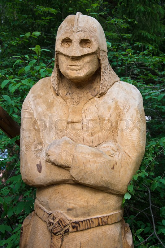 Stock image of 'Carved wooden figure in the forest.'