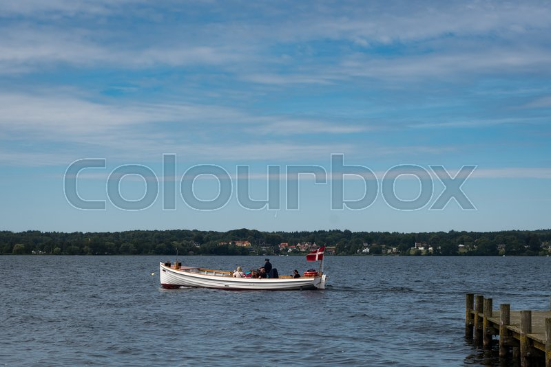 Editorial image of 'A retro-looking boat in Esrum sø'