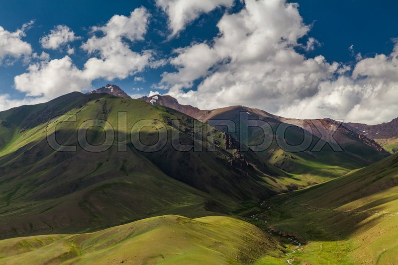 Stock image of 'View from pass to green valley and the mountains. Kyrgyzstan'