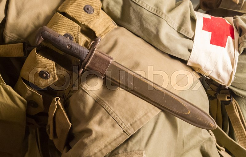Stock image of 'Close-up of a soldier with a knife, vintage'