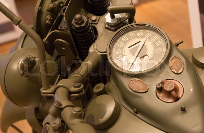 Stock image of 'Speedometer on a vintage motorcycle, selective focus'