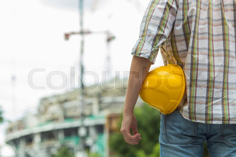 Stock image of 'Photo of man with yellow helmet on street'