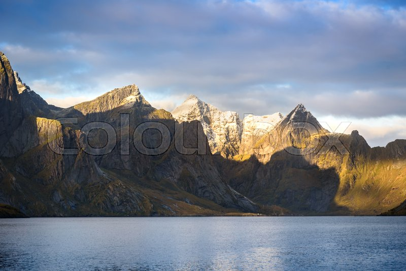 Stock image of 'Beautiful mountain and lake landscape in a morning with blue sky and cloudy, Lofoten, Norway'