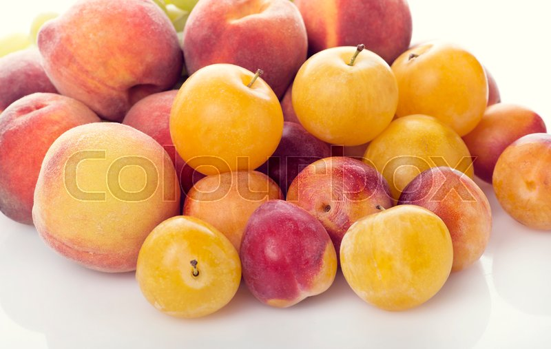 Stock image of 'Pile of colorful summer fruits - plums and peaches'