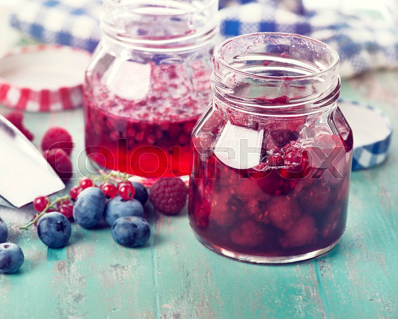 Stock image of 'homemade raspberry, blueberry and red currant jam '