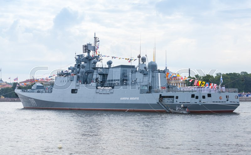 Editorial image of 'Saint-Petersburg, Russia - July 28, 2017: Warship stands moored on the Neva River. Rehearsal for the parade of Russian naval forces. Admiral Makarov is a frigate of the Admiral Grigorovich class'