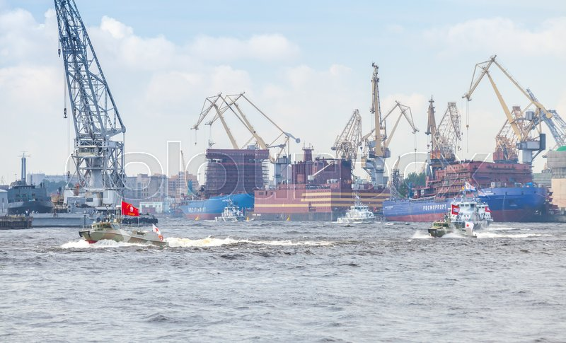 Editorial image of 'Saint-Petersburg, Russia - July 28, 2017: Small warships go on the Neva River. Rehearsal for the parade of Russian naval forces'