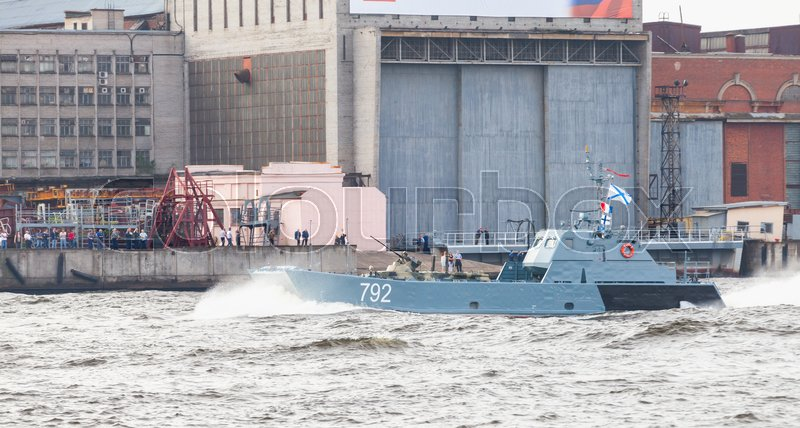 Editorial image of 'Saint-Petersburg, Russia - July 28, 2017: Warship goes on the Neva River. Rehearsal for the parade of Russian naval forces. Serna class landing craft, or Project 11770'