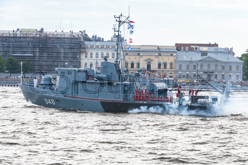Editorial image of 'Saint-Petersburg, Russia - July 28, 2017: Warship goes on the Neva River. Rehearsal for the parade of Russian naval forces. Tugboat of the Navy RB-348'