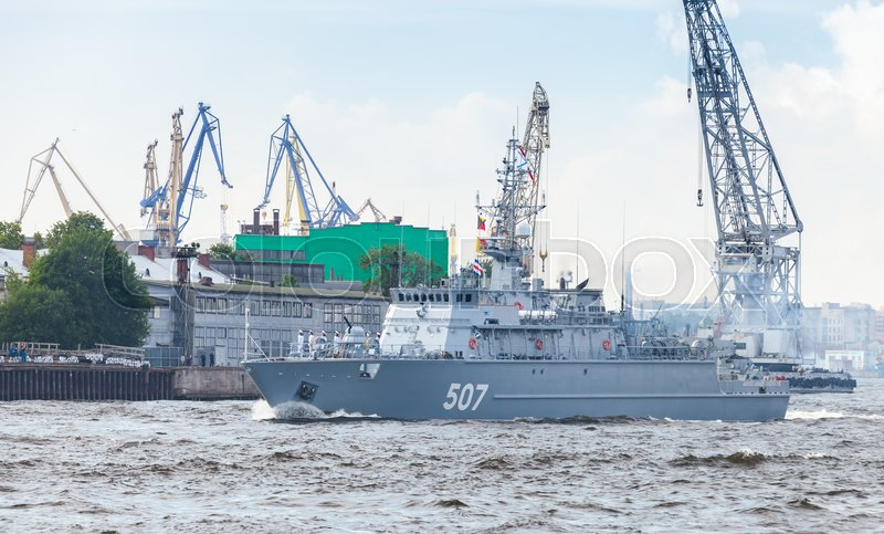 Editorial image of 'Saint-Petersburg, Russia - July 28, 2017: Warship goes on the Neva River. Rehearsal for the parade of Russian naval forces. Aleksandrit-class minesweeper, Project 12700'