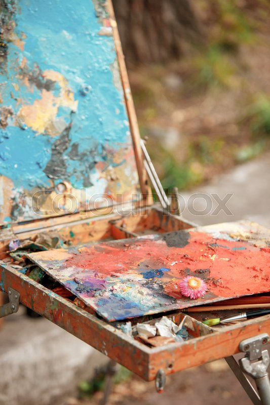 Stock image of 'The tools of the artist - paints and brushes on forest background'