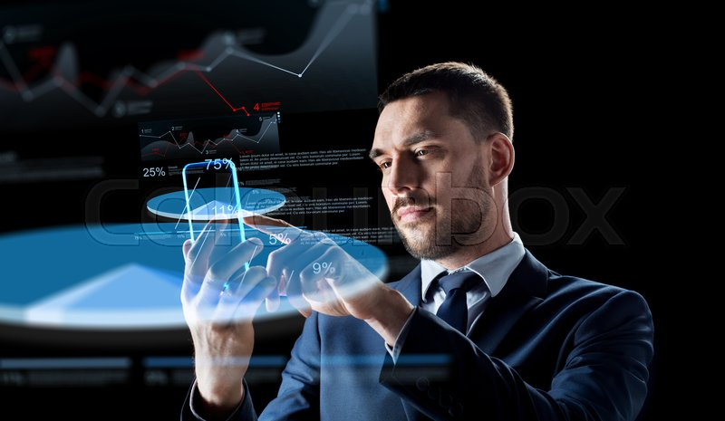 Stock image of 'business, augmented reality and modern technology concept - businessman working with transparent smartphone and virtual charts projections over black background'