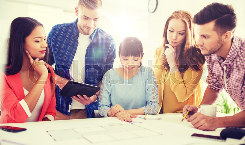Stock image of 'business, startup, education and people concept - creative architect team or students with blueprint working at office'