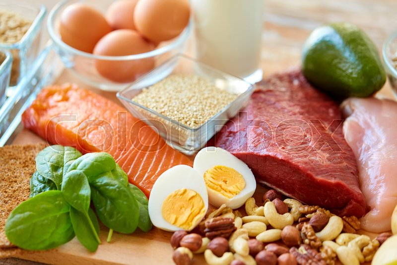 Stock image of 'healthy eating and diet concept - natural rich in protein food on table'