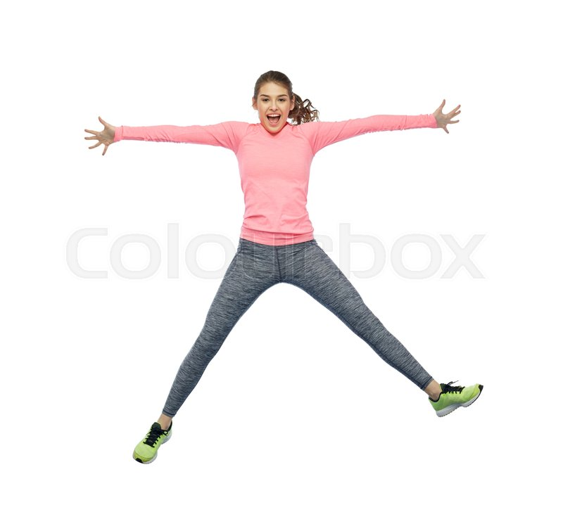 Stock image of 'sport, fitness, motion and people concept - happy smiling young woman jumping in air over white background'