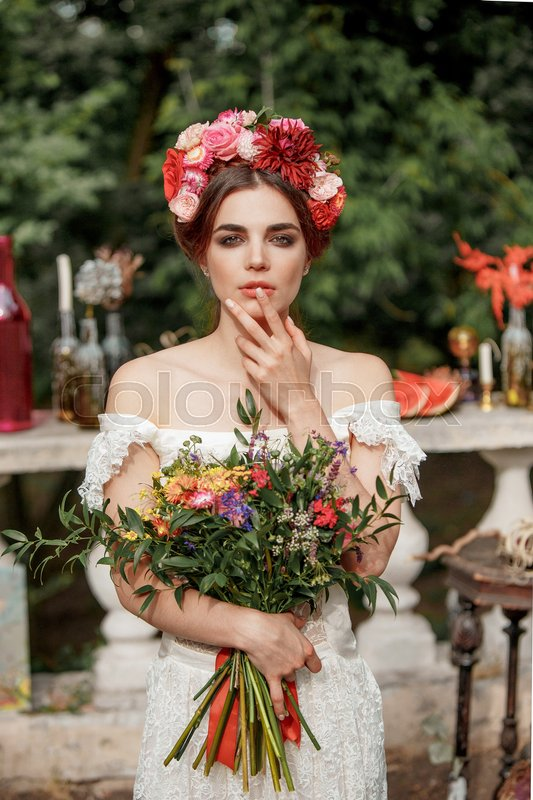 Stock image of 'Wedding decoration in the style of boho, floral arrangement, decorated table in the garden. Against the background of the bride'