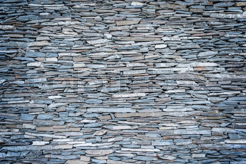 Stock image of 'Part of fence made from stones. Wall background.'