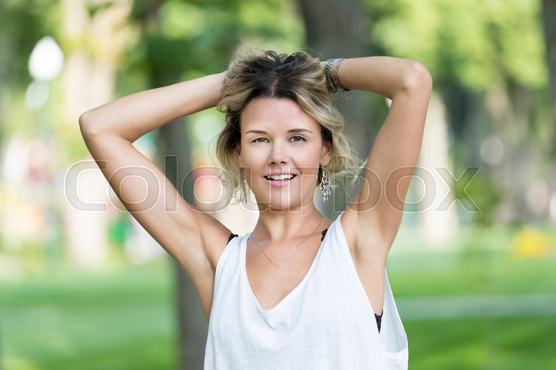 Stock image of 'Portrait of a girl in a summer park outdoors'