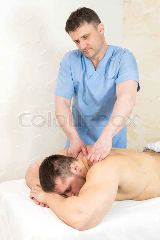 Stock image of 'Man doing sports massage at the massage parlor'