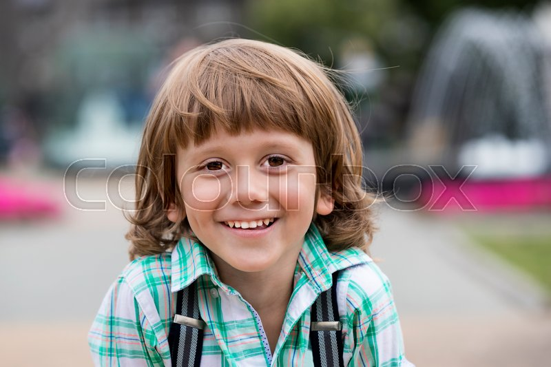 Stock image of 'Portrait of a boy on a background of green nature'