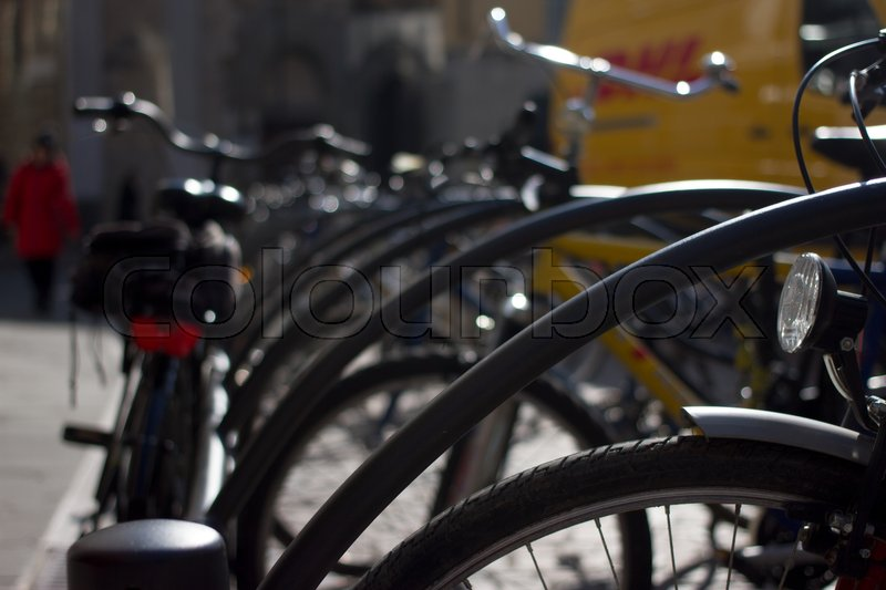 Stock image of 'Bicycle parking. Group of bikes. Rental cycle objects in city.'