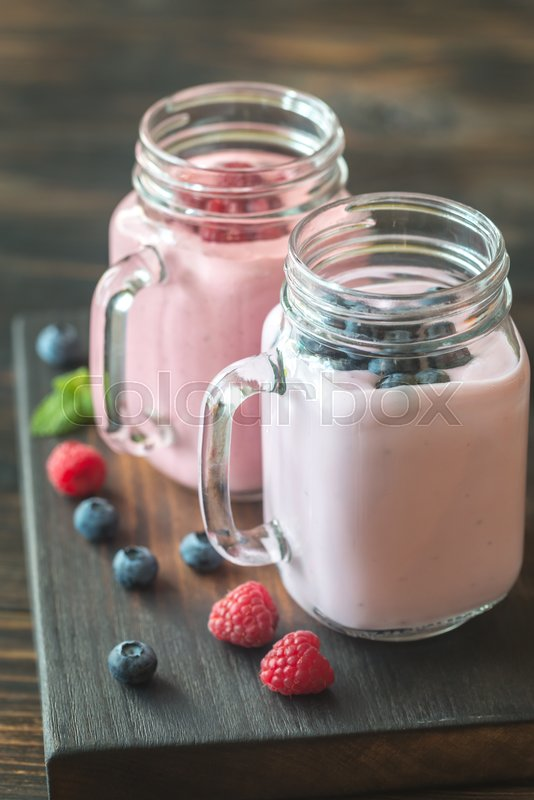 Stock image of 'Blueberry and raspberry smoothies'