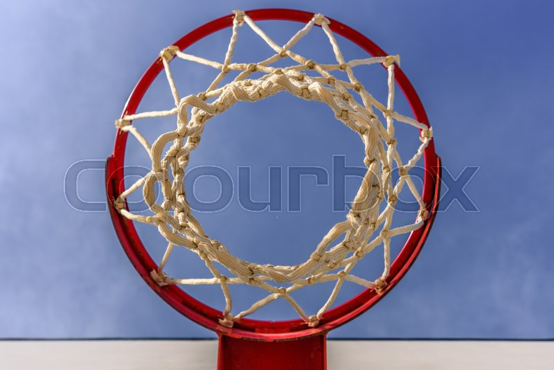 Stock image of 'Basketball hoop with blue sky.'