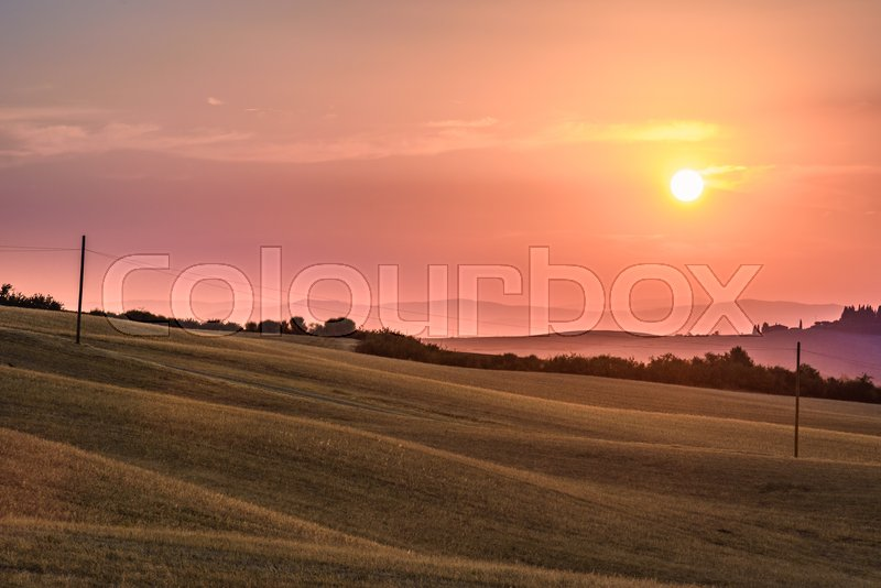 Stock image of 'PIENZA, ITALY - JULY 23, 2017 - View of the countryside of Val'dOrcia Natural Area in Tuscany during summer at sunset.'