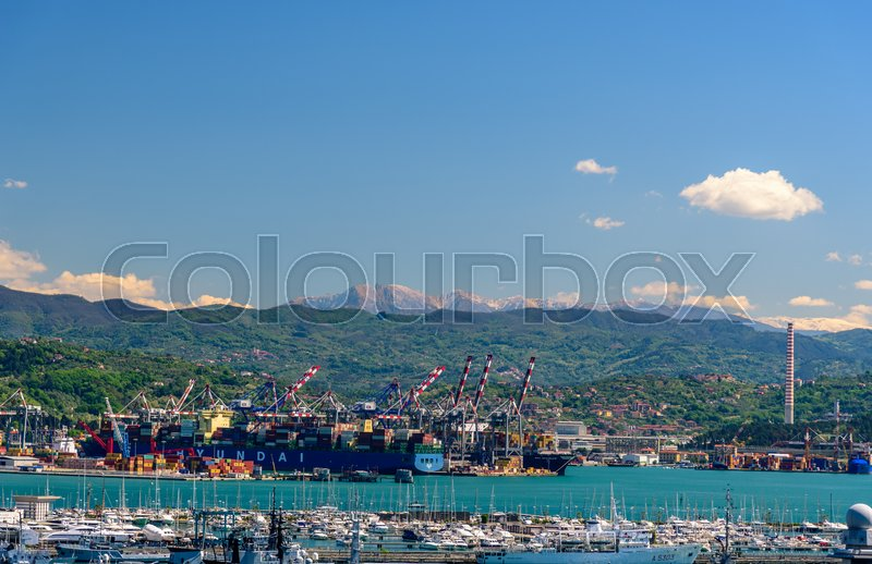 Stock image of 'LA SPEZIA, ITALY - APRIL 29, 2017 - View of the port of La Spezia with boats and mountains at the horizon.'