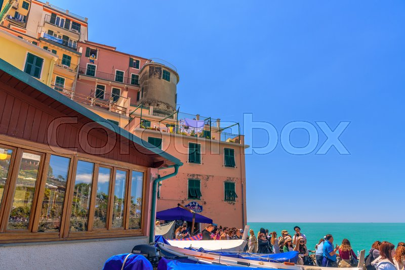 Stock image of 'MANAROLA, ITALY - APRIL 29, 2017 - View of the colorful house of the famous town of Riomaggiore in Liguria, inside the famous Cinque Terre National Park.'