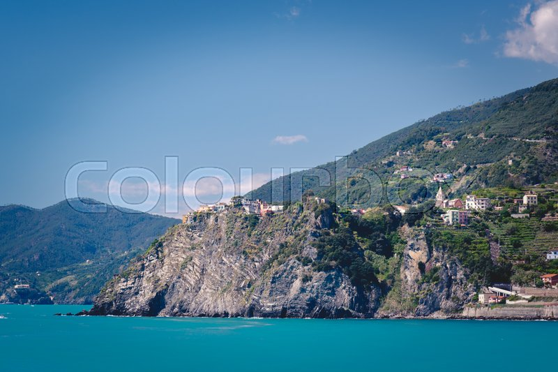 Stock image of 'Scenic view of the mediterrean sea and a town inside the Cinque Terre National Park, Liguria, Italy from the cliffs near Manarola.'
