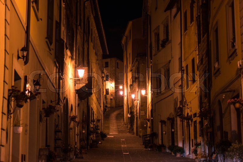 Stock image of 'MASSA MARITTIMA, ITALY - MAY 14, 2017 - Night view of a street in the historic center of Massa Marittima in the province of Grosseto in Tuscany.'