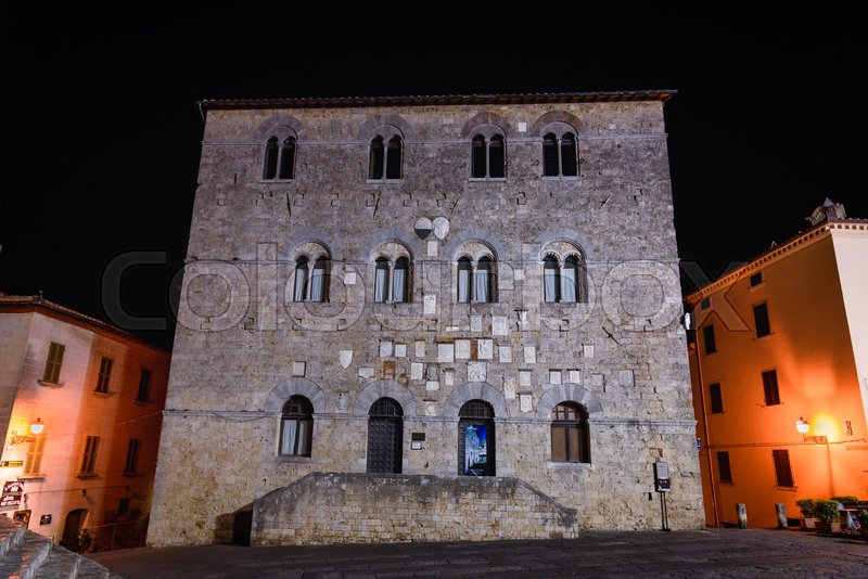 Stock image of 'MASSA MARITTIMA, ITALY - MAY 14, 2017 - Night view of the facade of the municipal building of Massa Marittima, a small town in the province of Grosseto in Tuscany.'