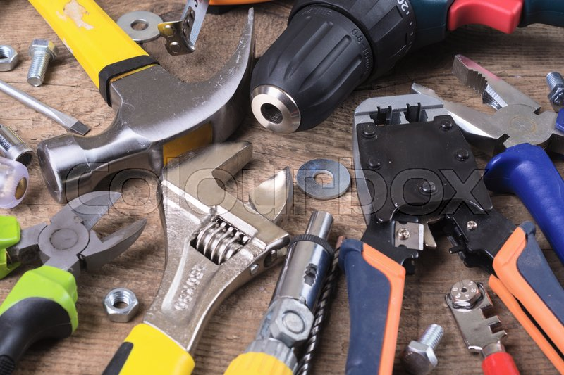 Stock image of 'Set of tools on wooden background .'