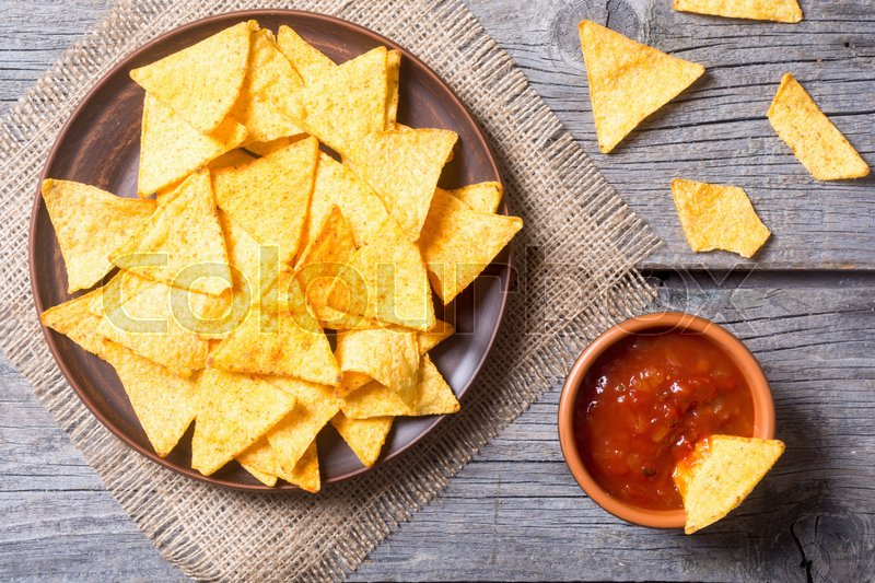 Stock image of 'Snack for party , chips , nachos with tomato sauces and tartar . Top view'