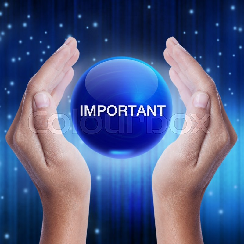 Stock image of 'Hand showing blue crystal ball with important word. business concept'