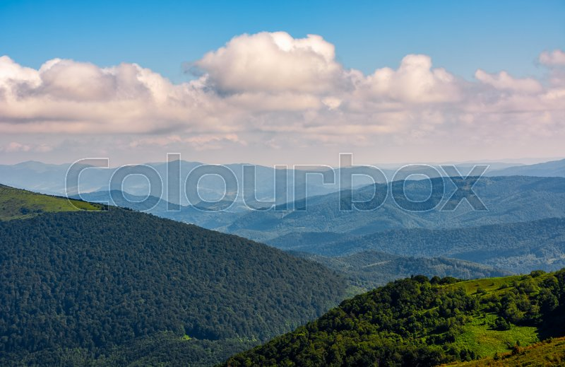 Stock image of 'gorgeous colorful cloudscape over the mountain ridge at sunrise'