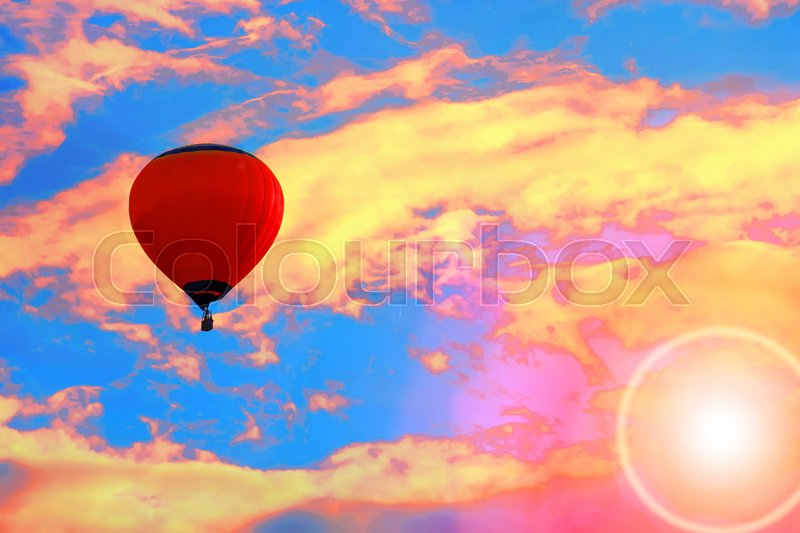 Stock image of 'Bright balloon in sunset colorful sky'