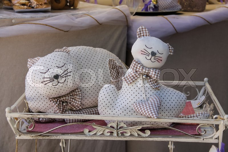 Editorial image of 'Grazzano Visconti, Italy - August 07, 2016: Decorative sleeping cats in souvenir shop'
