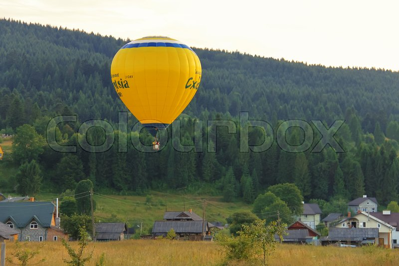 Editorial image of 'Schodnica, Ukraine - July 07, 2014: Yellow balloon in Carpatian hills'