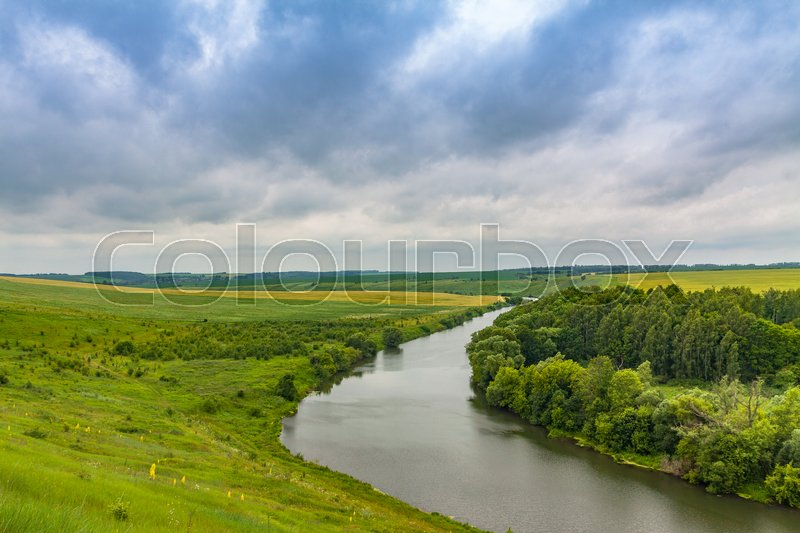 Stock image of 'View from the top of the hill on the river'