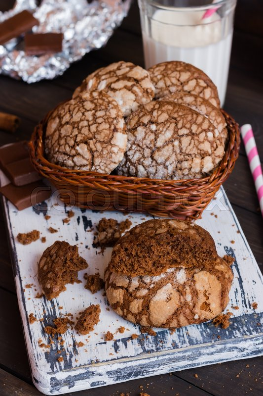 Stock image of 'Chocolate biscuits with cracks on a dark wooden background'