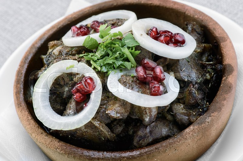Stock image of 'Georgian dish kuchmachi on a clay plate'