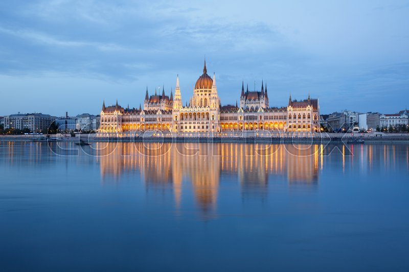 Editorial image of 'Budapest Parliament building at evening on the Danube river in Hungary. '
