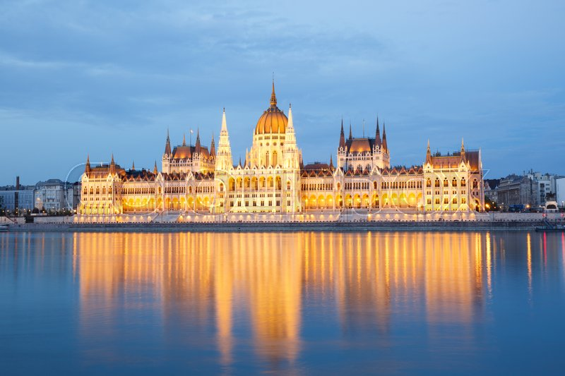 Editorial image of 'The building of Parliament with reflection in the river in Budapest at sunset. Hungary '